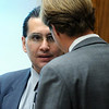 ABEYTA32.JPG ABEYTA32<br /> Joseph Abeyta, left, talks with his lawyer, Jason Savela, during his trial on Wednesday.<br /> <br /> Photo by Marty Caivano/Camera/Oct. 21, 2009/