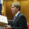"ABEYTA03<br /> Defense attorney Jason Savela uses a cardboard box as an analogy for the ""box"" of the drug world Joseph Abeyta and William Andrews were living in during the crime spree that resulted in Andrews' death last January. Savela gave his opening argument Wednesday during Abeyta's trial, where Abeyta is accused of murdering Andrews.<br /> Photo by Marty Caivano/Camera/Oct. 14, 2009/"