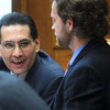 ABEYTA01<br /> Defendant Joseph Abeyta, left, talks to lawyer David Jones between  opening arguments during his trial on Wednesday. Abeyta is accused of murdering his friend, William Andrews, in north Boulder in January 2009.<br /> Photo by Marty Caivano/Camera/Oct. 14, 2009
