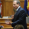 ABEYTA02<br /> District Attorney Stan Garnett demonstrates how Joseph Abeyta shot his friend William Andrews with a pump shotgun during opening arguments in Abeyta's trial on Wednesday. Abeyta is accused of murdering Andrews in north Boulder in January 2009.<br /> <br /> Photo by Marty Caivano/Camera/Oct. 14, 2009/