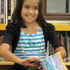 Melody Mendoza, 8, smiles while preparing to read a book  during the student presentation at the Jump Start literacy and math camp at Emerald Elementary School on Thursday.<br /> July 28, 2011<br /> staff photo/ David R. Jennings
