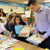 Melody Mendoza, 8, collects free books with her father Eddie after the  student presentation at the Jump Start literacy and math camp at Emerald Elementary School on Thursday.<br /> July 28, 2011<br /> staff photo/ David R. Jennings