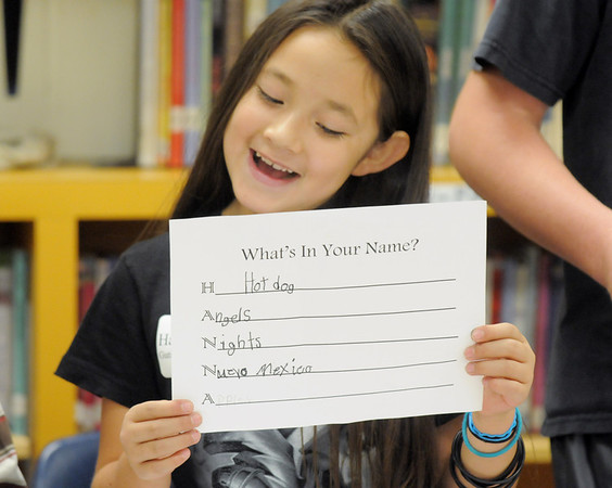 Hanna Gutierrez-Castaneda, 8, reads a story during the student presentation at the Jump Start literacy and math camp at Emerald Elementary School on Thursday.<br /> July 28, 2011<br /> staff photo/ David R. Jennings