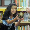 Melody Mendoza, 8, catches a ball of string while helping recite a poem about a spider during the student presentation of the Jump Start literacy and math camp at Emerald Elementary School on Thursday.<br /> July 28, 2011<br /> staff photo/ David R. Jennings