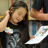 Hanna Gutierrez-Castaneda, 8, reads a story during student presentation at the Jump Start literacy and math camp at Emerald elementary School on Thursday.<br /> July 28, 2011<br /> staff photo/ David R. Jennings