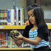 Melody Mendoza, 8, catches a ball of string while helping recite a poem about a spider during student presentation at the Jump Start literacy and math camp at Emerald Elementary School on Thursday.<br /> July 28, 2011<br /> staff photo/ David R. Jennings