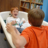 Tony Akers, 8, sits in the reading tub with his brother Michael, 9, at Emerald Elementary School after the Jump Start literacy and math camp student presentation on Thursday.<br /> July 28, 2011<br /> staff photo/ David R. Jennings