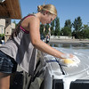 Christina Nuss-Brill, 17, washes a car during Saturday's Kelsey Marie Shannon memorial carwash at Family of Christ Church .<br /> August 27, 2011<br /> staff photo/ David R. Jennings