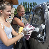 Audra Hedberg, 16,left,  and Christina Nuss-Brill, 17, wash a car during Saturday's Kelsey Marie Shannon memorial carwash at Family of Christ Church .<br /> August 27, 2011<br /> staff photo/ David R. Jennings