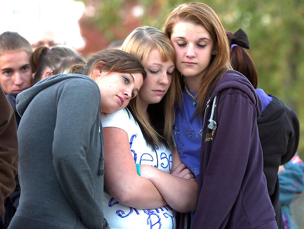 Hannah Harmon, 17, left, Halie Lower, 16, and Rachel Volesky, 16, friends of Kelsey Marie Shannon comfort each other at the dedication of Kelsey's Bridge on Lowell Blvd. in the Broadlands on Friday.<br /> October 14, 2011<br /> staff photo/ David R. Jennings