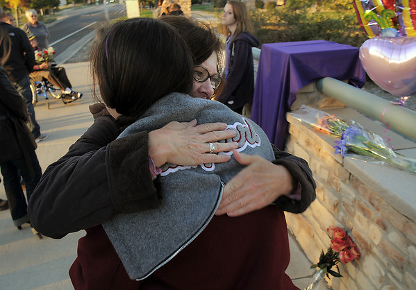 Dottie Shannon hugs Dominique Giampieri, 16, the organizer of the dedication of Kelsey's Bridge in memory of Kelsey Marie Shannon, Dottie's daughter, on Lowell Blvd. in the Broadlands on Friday.<br /> <br /> October 14, 2011<br /> staff photo/ David R. Jennings