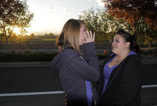 Rachel Volesky, 16, left, is comforted by her friend Michaela Mattila, 16, at  the dedication of Kelsey's Bridge in memory of their friend, Kelsey Marie Shannon, on Lowell Blvd. in the Broadlands on Friday.<br /> October 14, 2011<br /> staff photo/ David R. Jennings