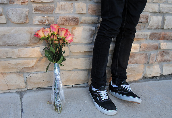 Dillon Pixler, 17, stand by flowers at the dedication of Kelsey's Bridge in memory of Kelsey Marie Shannon on Lowell Blvd. in the Broadlands on Friday.<br /> October 14, 2011<br /> staff photo/ David R. Jennings