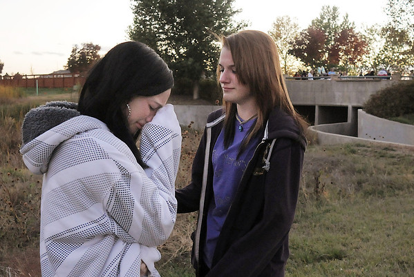 Friends of Kelsey Marie Shannon Kayla Stephenson, 16, left, and Rachel Volesky, 16, cry and comfort each other after the dedication of Kelsey's Bridge, in the back ground, on Lowell Blvd. in the Broadlands on Friday.<br /> <br /> October 14, 2011<br /> staff photo/ David R. Jennings
