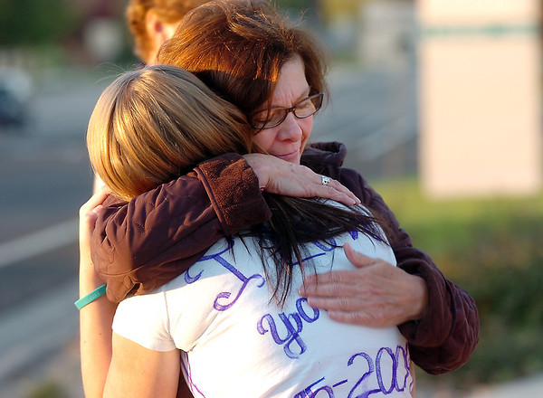 Dottie Shannon hugs Halie Lower, 16, before the dedication ceremony of Kelsey's Bridge in memory of Kelsey Marie Shannon, Dottie's daughter, on Lowell Blvd. in the Broadlands on Friday.<br /> <br /> October 14, 2011<br /> staff photo/ David R. Jennings