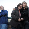 Dottie Shannon, center, is comforted by Judy Giampiari, right,  with Dottie's husband Tom, left, at the dedication of Kelsey's Bridge in memory of Kelsey Marie Shannon, Tom and Dottie's daughter, on Lowell Blvd. in the Broadlands on Friday.<br /> October 14, 2011<br /> staff photo/ David R. Jennings