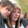 Hannah Harmon, 17, left, comforts Halie Lower, 16, at the dedication of Kelsey's Bridge in memory of Kelsey Marie Shannon on Lowell Blvd. in the Broadlands on Friday.<br /> October 14, 2011<br /> staff photo/ David R. Jennings