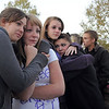 Friends of Kelsey Marie Shannon comfort each other, Hannah Harmon, 17, left, with Halie Lower, 16, Rachel Volesky, 16, Michaela Mattila, 16, and Colin Clark, 18, at the dedication of Kelsey's Bridge in memory of Shannon on Lowell Blvd. in the Broadlands on Friday.<br /> October 14, 2011<br /> staff photo/ David R. Jennings