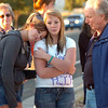 Hannah Harmon, 17, left, Halie Lower, 16, with Tom Shannon father of  Kelsey Marie Shannon comfort each other during the dedication ceremony of Kelsey's Bridge on Lowell Blvd. in the Broadlands on Friday.<br /> October 14, 2011<br /> staff photo/ David R. Jennings