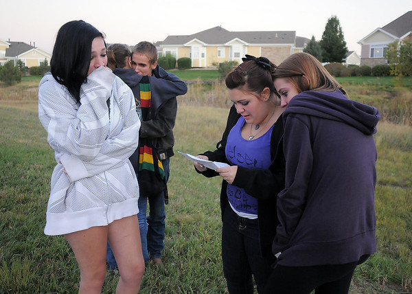 Friends of Kelsey Marie Shannon Kayla Stephenson, 16, left, Michaela Mattila, 16, and Rachel Volesky, 16, with Jordan Traphagen, 16, and Colin Clark, 18, comfort each other and read poems in memory of Shannon after  the dedication of Kelsey's Bridge in the Broadlands on Friday.<br /> October 14, 2011<br /> staff photo/ David R. Jennings