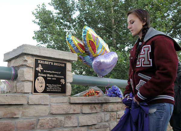 Dominique Giampieri, 16, unveils the plaque dedicating Kelsey's Bridge in memory of Kelsey Marie Shannon, on Lowell Blvd. in the Broadlands on Friday.<br /> <br /> October 14, 2011<br /> staff photo/ David R. Jennings
