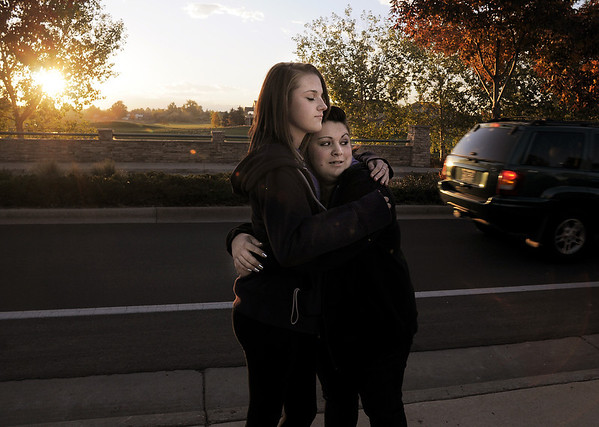 Rachel Volesky, 16, left, and Michaela Mattila, 16, comfort each other as the sunset during the dedication of Kelsey's Bridge in memory of their friend, Kelsey Marie Shannon, on Lowell Blvd. in the Broadlands on Friday.<br /> <br /> October 14, 2011<br /> staff photo/ David R. Jennings