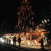 "Fans look at Kim Weibert's holiday lighting display at 1188 Clubhouse Drive. Weibert had help setting up the display from her father John Weibert, 82 and father-in-law Marvin Hart in honor of Kim's partner Kevin who passed away last Christmas day.<br /> More photos please see  <a href=""http://www.broomfieldenterprise.com"">http://www.broomfieldenterprise.com</a><br /> December 9, 2011<br /> Staff photo/ David R. Jennings"