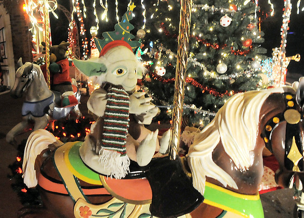"A yoda doll rides a horse on the carousel in Kim Weibert's holiday lighting display at 1188 Clubhouse Drive.<br /> More photos please see  <a href=""http://www.broomfieldenterprise.com"">http://www.broomfieldenterprise.com</a><br /> December 9, 2011<br /> Staff photo/ David R. Jennings"