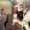 "Jostyn Hillesheim, 6, looks at the carousel in Kim Weibert's holiday lighting display at 1188 Clubhouse Drive.<br /> More photos please see  <a href=""http://www.broomfieldenterprise.com"">http://www.broomfieldenterprise.com</a><br /> December 9, 2011<br /> Staff photo/ David R. Jennings"