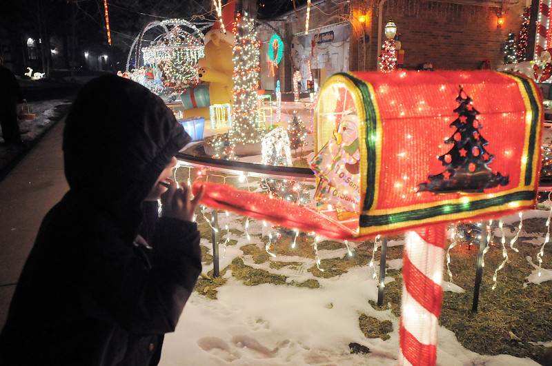 """Zachery Dieke, 6, watches the animated mailbox in Kim Weibert's holiday lighting display at 1188 Clubhouse Drive.<br /> More photos please see  <a href=""""http://www.broomfieldenterprise.com"""">http://www.broomfieldenterprise.com</a><br /> December 9, 2011<br /> Staff photo/ David R. Jennings"""