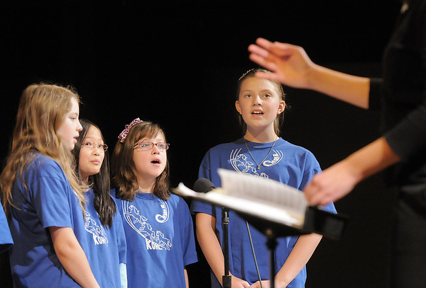 """Haley Urbanek, left, Beka Sutton, Alyssa Miller, and Rachel Emory sing """"Build Me A Better World"""" during the Kohl Elementary Holiday Choir performance for seniors conducted by Jayanthi Bunyan at the Audi on Friday.<br /> <br /> December 8, 2011<br /> Staff photo/ David R. Jennings"""