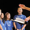 "Haley Urbanek, left, Beka Sutton, Alyssa Miller, and Rachel Emory sing ""Build Me A Better World"" during the Kohl Elementary Holiday Choir performance for seniors conducted by Jayanthi Bunyan at the Audi on Friday.<br /> <br /> December 8, 2011<br /> Staff photo/ David R. Jennings"