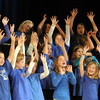 The Kohl Elementary Holiday Choir raise theri arms in the air during their performance for seniors conducted by Jayanthi Bunyan at the Audi on Friday.<br /> <br /> December 8, 2011<br /> Staff photo/ David R. Jennings