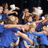 "The Kohl Elementary Holiday Choir throws cotton to sumulate snow as they sing "" Seven Feet of Snow "" during their performance for seniors conducted by Jayanthi Bunyan at the Audi on Friday.<br /> <br /> December 8, 2011<br /> Staff photo/ David R. Jennings"