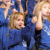 Anna Belle Haggard, fourth grader, sings while pretending to play a horn during the Kohl Elementary Holiday Choir performance for seniors conducted by Jayanthi Bunyan at the Audi on Friday. The 66 member choir is made up of fourth and fith graders.<br /> <br /> December 8, 2011<br /> Staff photo/ David R. Jennings