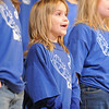 Anna Belle Haggard, fourth grader, sings during the Kohl Elementary Holiday Choir performance for seniors conducted by Jayanthi Bunyan at the Audi on Friday. The 66 member choir is made up of fourth and fith graders.<br /> <br /> December 8, 2011<br /> Staff photo/ David R. Jennings