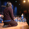 "Kohl Elementary Holiday Choir conductor Jayanthi Bunyan watches John Zack sing a solo, "" Here Comes Santa Claus "", for seniors at the Audi on Friday.<br /> <br /> December 8, 2011<br /> Staff photo/ David R. Jennings"