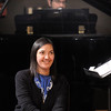 Conductor by Jayanthi Bunyan, with pianist Adam Ewing, watches the Kohl Elementary Holiday Choir performance for seniors at the Audi on Friday.<br /> <br /> December 8, 2011<br /> Staff photo/ David R. Jennings
