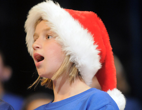 Fourth grader Ellie Gentry sings while wearing her Santa hat during the performance of the Kohl Elementary Holiday Choir for seniors at the Audi on Friday.<br /> December 8, 2011<br /> Staff photo/ David R. Jennings