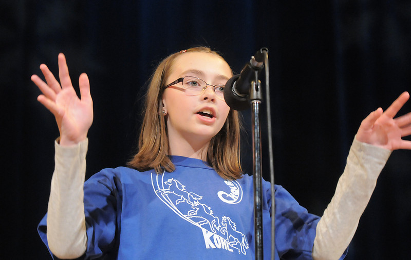 "Julia Boggs sings  a solo of "" Jingle Bell Rock "" during the Kohl Elementary Holiday Choir performance for seniors conducted by Jayanthi Bunyan at the Audi on Friday.<br /> <br /> December 8, 2011<br /> Staff photo/ David R. Jennings"