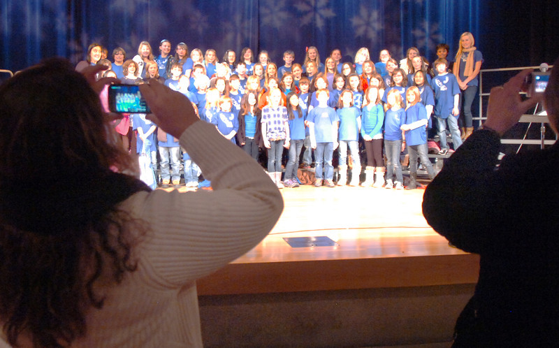 Parents take pictures of the Kohl Elementary Holiday Choir after their holiday performance for seniors conducted by Jayanthi Bunyan at the Audi on Friday.<br /> <br /> December 8, 2011<br /> Staff photo/ David R. Jennings