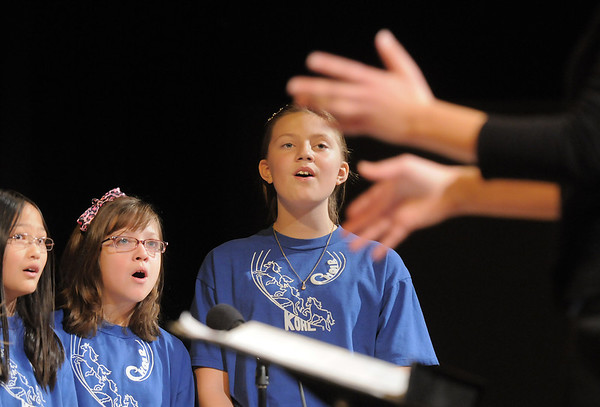 """Beka Sutton, left, Alyssa Miller, and Rachel Emory sing """"Build Me A Better World"""" during the Kohl Elementary Holiday Choir performance for seniors conducted by Jayanthi Bunyan at the Audi on Friday.<br /> <br /> December 8, 2011<br /> Staff photo/ David R. Jennings"""