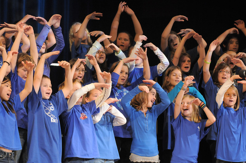 "The Kohl Elementary Holiday Choir gestures as they sings "" Seven Feet of Snow "" during their performance for seniors conducted by Jayanthi Bunyan at the Audi on Friday.<br /> <br /> December 8, 2011<br /> Staff photo/ David R. Jennings"