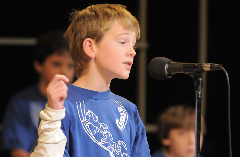 "Fifth grader John Zack sings "" Here Comes Santa Claus ""  during the Kohl Elementary Holiday Choir performance for seniors conducted by Jayanthi Bunyan at the Audi on Friday.<br /> <br /> December 8, 2011<br /> Staff photo/ David R. Jennings"