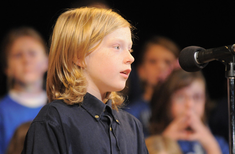 Jonah French-Jurgens, fourth grader, introduces a song during the Kohl Elementary Holiday Choir performance for seniors conducted by Jayanthi Bunyan at the Audi on Friday.<br /> <br /> December 8, 2011<br /> Staff photo/ David R. Jennings