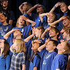 The Kohl Elementary Holiday Choir make a dramatic gesture during their performance for seniors conducted by Jayanthi Bunyan at the Audi on Friday.<br /> <br /> December 8, 2011<br /> Staff photo/ David R. Jennings