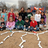 Students in Kohl Elementary School's Friday afternoon K-CARE program pose with the plastic dinosaur bones they found in the playground.<br /> <br /> November 13, 2009<br /> Staff photo/David R. Jennings