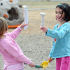 Kindergartner Madeline Witte, left, and Anna Rehak compare their plastic dinosaur bone finds during Kohl Elementary School's Friday afternoon K-CARE program.<br /> November 13, 2009<br /> Staff photo/David R. Jennings