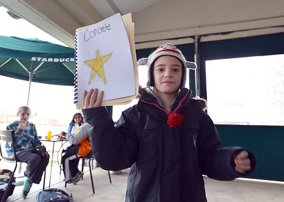 """Kohl Elementary fourth grader Amara Poe, after reading her poem """"Concrete"""",  shows how the poem was written during Mrs. Fields' Poetry Cafe class at the 287 and Miramonte Starbucks on Friday.  December 14, 2012 staff photo/ David R. Jennings"""