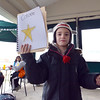 """Kohl Elementary fourth grader Amara Poe, after reading her poem """"Concrete"""",  shows how the poem was written during Mrs. Fields' Poetry Cafe class at the 287 and Miramonte Starbucks on Friday.<br /> <br /> December 14, 2012<br /> staff photo/ David R. Jennings"""